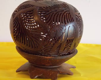 New listing.......A hand carved coconut shell, showing elephants and foliage.