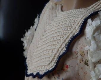 Cream Crochet Bib With Navy Edging