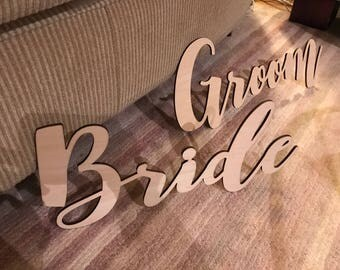 tailor made Bride and Groom wood piece