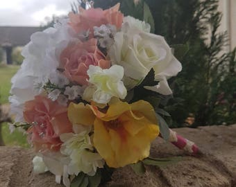 White and pink artificial wedding bouquet with two bridesmaids bouquets and groom and best man button holes.