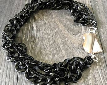 black chain necklace with beige/brown black and white