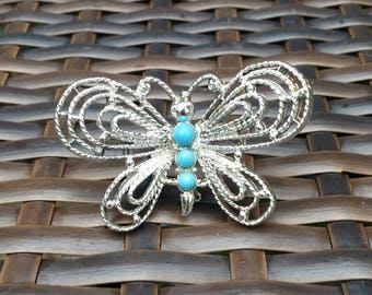 """Butterfly Brooch, Signed """"Gerrys"""" - Silver tone metal wings with turquoise dyed stones for body"""