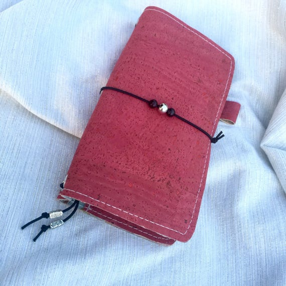 Cute personal sized refillable traveler's notebook in beautiful cranberry red natural cork perfect for planning, journaling, etc.