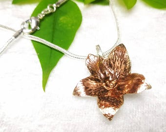 Jasmin Flower pendant. Argentium Silver. Rose gold plated detail. 3cm/2.5cm. Free chain and UK delivery.