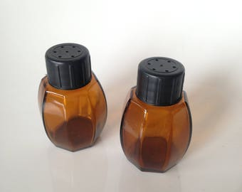 Salt and pepper shakers in plastic and smoked glass - vintage