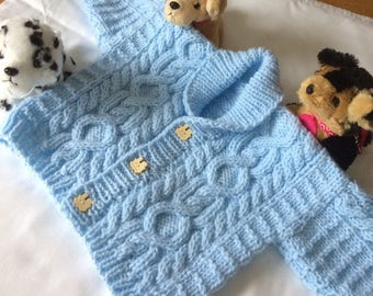 Aran, roll neck, child's hand knitted jacket