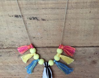 Handmade cotton tassel and clay bead necklace on silver chain