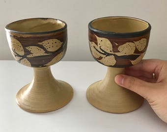 Set of 2 goblets - tropical floral beige, brick red, and black - Pacific Stoneware USA by B Welsh 1972