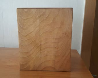 simple urn made of beech wood