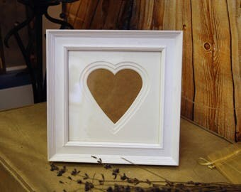 Rustic white frame with triple white heart mount