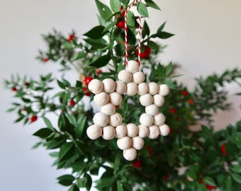 Ornament with wooden beads