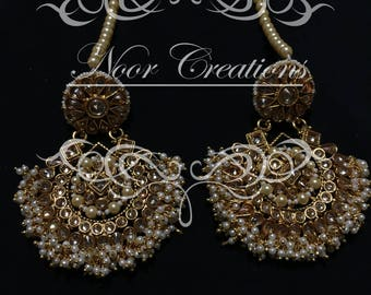 Gold Intricate Kundan with White Pearls Earrings with Matching Tikka