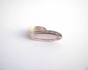 T silver spoon ring. 60-61
