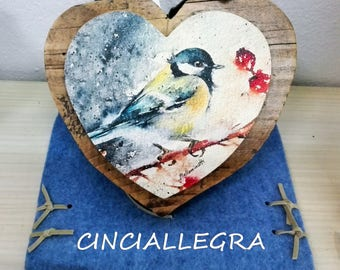 Wooden heart with image of flowers or animals