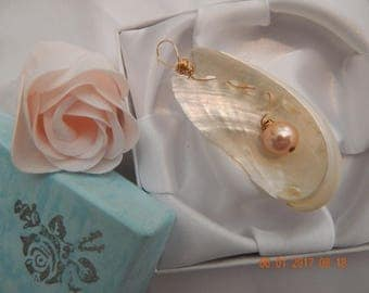 White seashell with pink pearl in center pendant