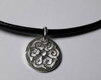 Leather necklace with a small trailer