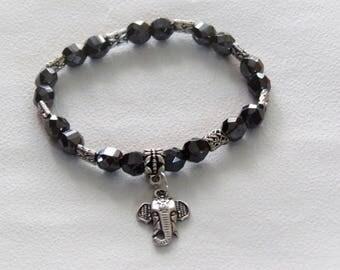 Grey elastic bracelet with elephant charm