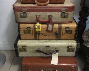 Assortment of functional vintage luggage used as wedding props