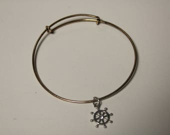 Gold Plated Crosswire bracelet with wheel charm