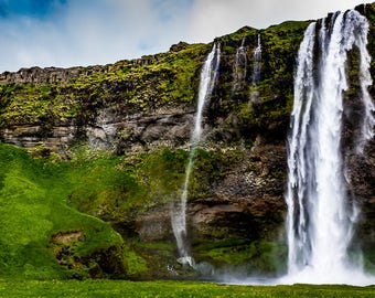 Iceland - Waterfalls surrounded by lush green grass