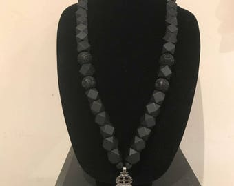 Black geometry beads with cinnabar beads and silver meskel