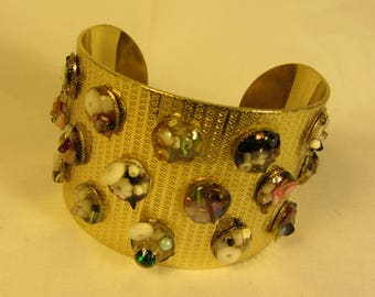 Chunky Gold Cuff Bracelet with Etched Design and Metal Discs of Embellishments