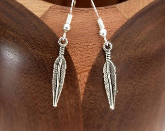 Silver feathers, large clip earrings silver feathers