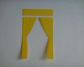 A pair of curtains cut yellow for scrapbooking and card
