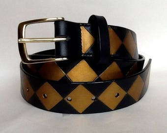 "1 1/4 "" wide handmade hand painted black leather belt with a solid brass buckle and decorated with a diamond design"