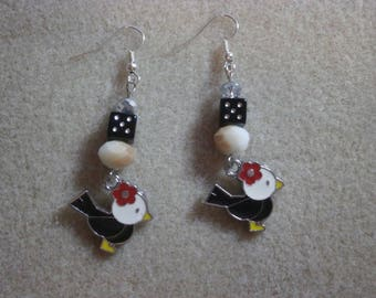 """Bird"" Black Dice earrings."