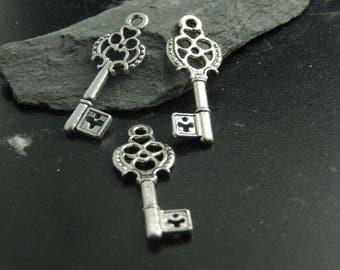 4 silver metal key charms