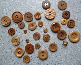30 buttons in various brown colored resin