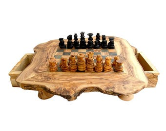 A Rustic chessboard with drawer made with olive wood