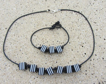 Cubic striped black and white, original and lightweight beads and crew neck and black waxed cotton bracelet set
