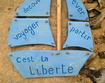 """wooden sign boat """"is freedom"""""""