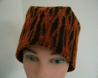 Crochet Hat toque created orange wool and a touch of green.