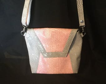 """""""Dragon"""" gray and pink leatherette bag."""