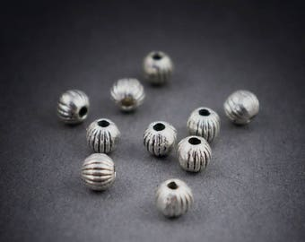 10pcs - small round beads surrounded by metal spacers • Silver • 3mm