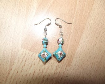 Dangle earrings with blue beads.