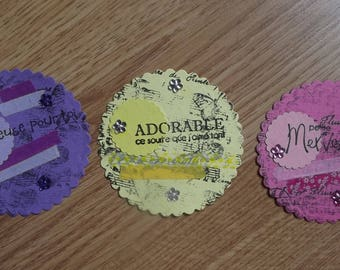 3 tags, 1 pink, 1 Purple and 1 yellow for your scrapbooking creations.