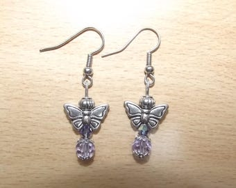 Purple earrings with butterfly charms.