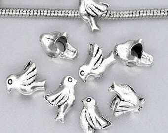 2 beads with large holes, bird of peace in silver