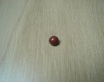 Brown plastic tail domed button
