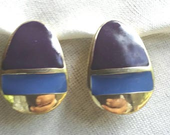 Vintage signed Original by Robert Purple, Blue enamel on gold tone metal curved disc. Clip on earrings