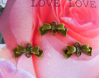 metal bow connector charms bronze set of 3