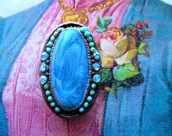 Locket vintage style blue outline marbled cabochon copper colored metal and blue rhinestones