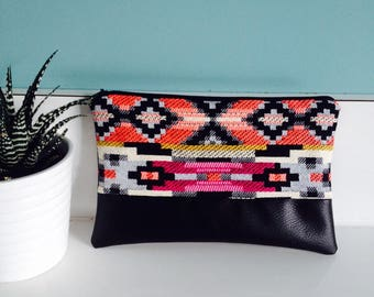 """Fuchsia"" geometric and black pouch"