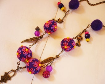 necklace made of wool felt and embroidered beads, pink and Yellow violets.
