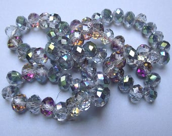 Set of 24 beads crystal glass faceted 8 x 5 mm.