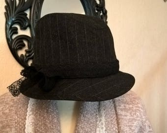 Hats in wool with black and gray stripes